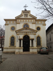 Romanians do the sign of the cross three times when passing a church