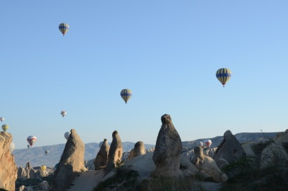 These rocks look like penguins watching the balloon show