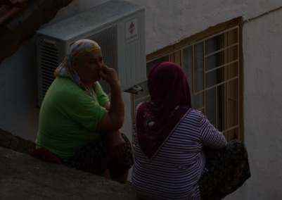 two ladies chat during sunset. I just love all their colorful clothes!