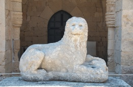 this is a lion with a bull in its paws - it was on a headstone