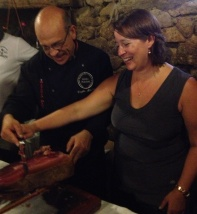 learning to cut jamon iberica during an excursion