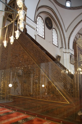 the minbar. If you can see behind the plexiglass, check out the solar system!