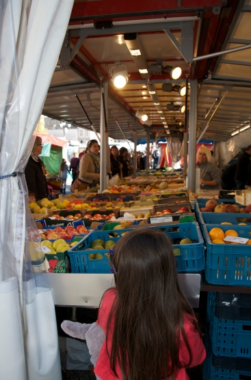 a girl checks out the produce